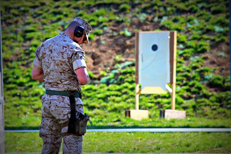 military marine corps pistol qualification pistol range shooting  photo