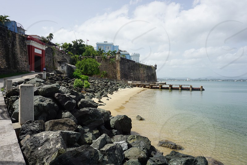 Tiny people big places fort wall ancient history people sea ocean beach island tropical  photo