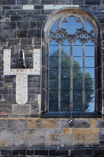 Reflection in Stain Glass window of the Old Church of Enschede the Netherlands. photo