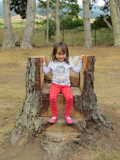 Child smiling outdoors photo