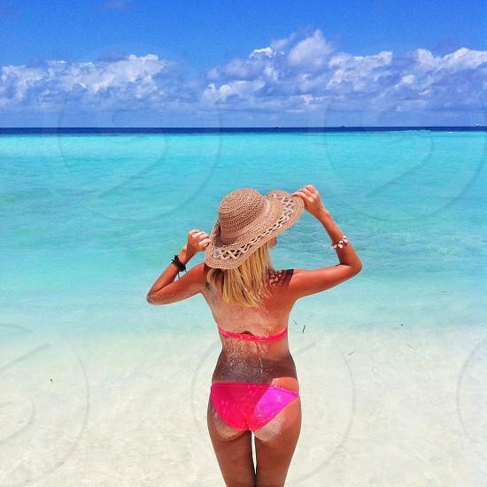 woman in pink bikini on tropical beach photo
