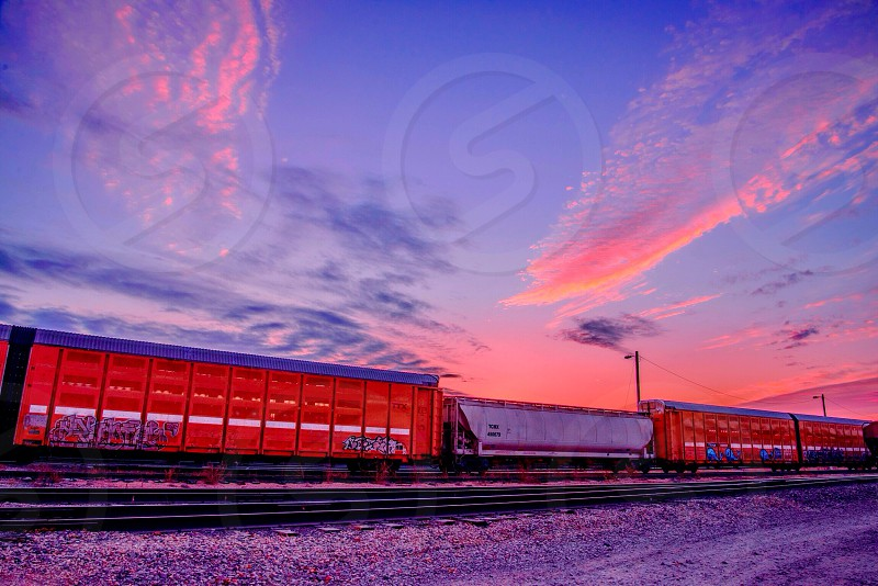 A freight train passing by at sunset on 11/12/14. photo