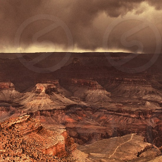 canyon with rocky peaks under cloudy sky photo