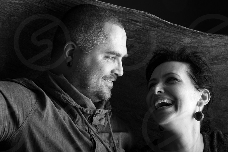 Young couple laughing photo