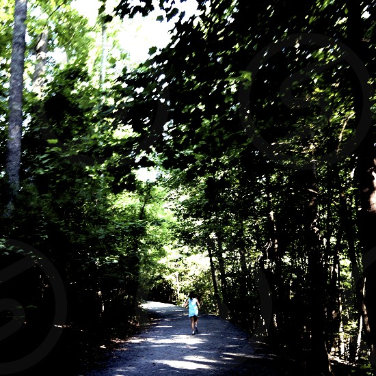 woman running in the woods photo