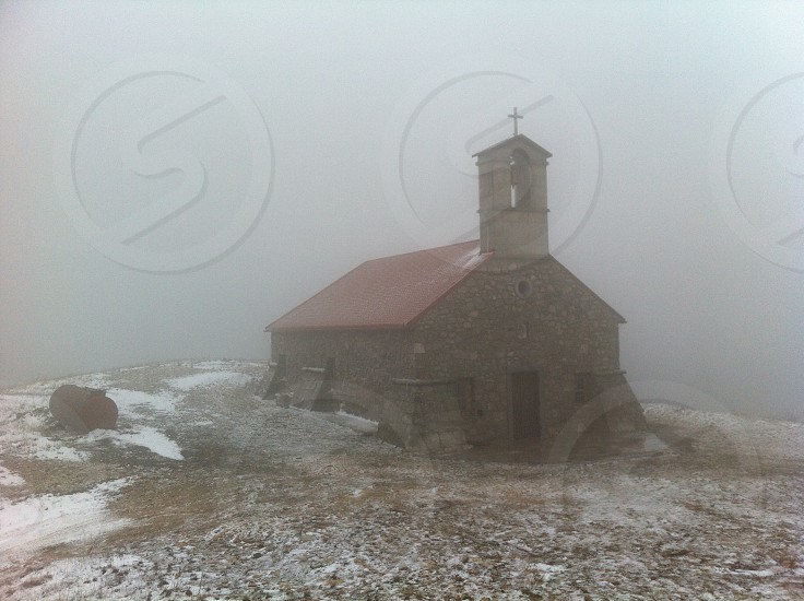church architecture building christianity bell cross fog foggy photo