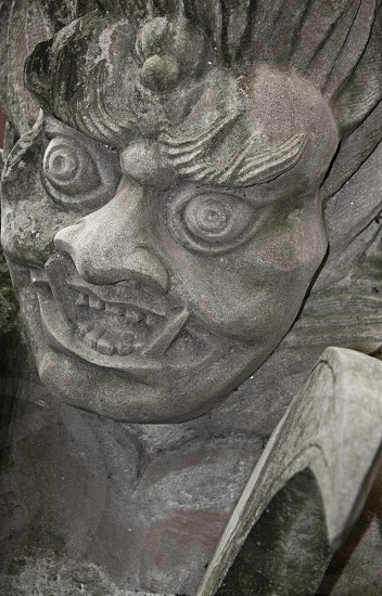 Demon evil statue in stone. An ancient statue from the Ghost City of Fengdu along the Yangtze River China. photo