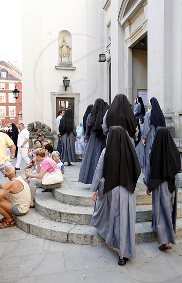 a streetszene in the old town  in the City of Warsaw in Poland East Europe. photo