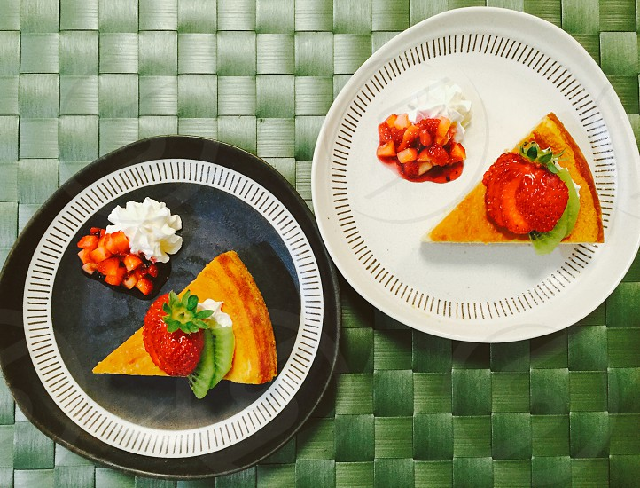 pie with strawberry on white and black ceramic round plate photo
