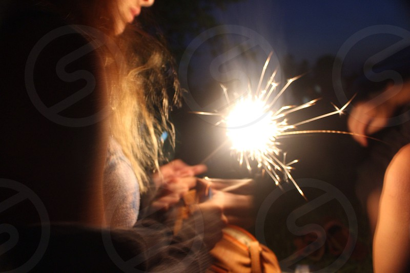 woman playing with sparkler photo