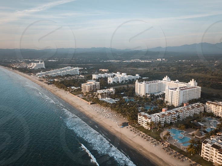 Early morning aerial view at stretch of beach with hotels at Nuevo Vallarta Riviera Nayarit Mexico. photo