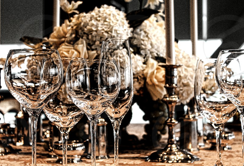Fine crystal glasses are part of an elegant table setting. photo