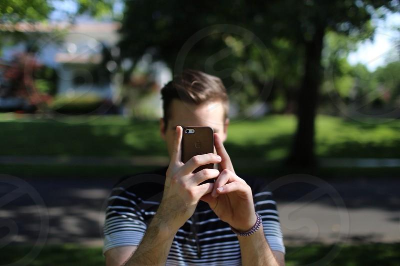 men's blue white striped shirt photo