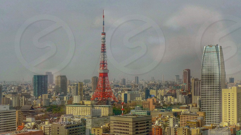red tower in the middle of the city photo