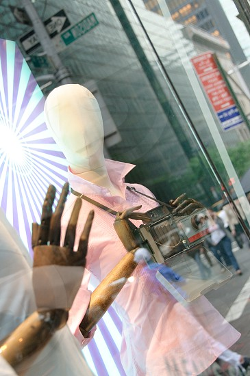 NYC mannequin photographer store window reflection photo