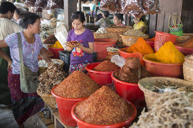 a curry shop at a marketstreet in the City of Mandalay in Myanmar in Southeastasia. photo