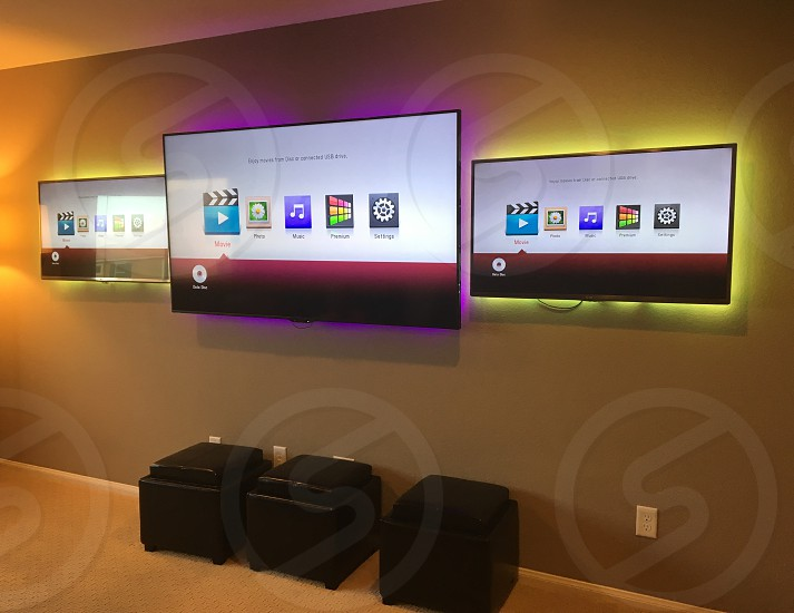 TVs mounted on game room wall photo