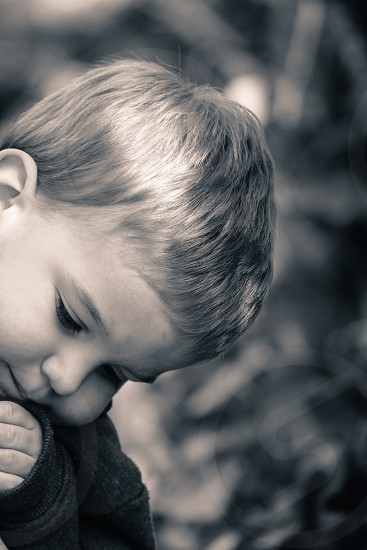 Photograph of child day dreaming photo
