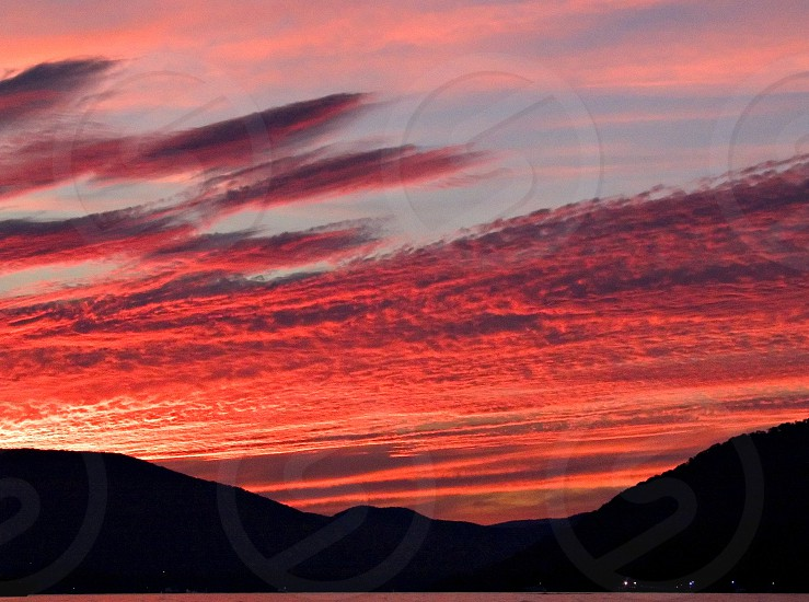 silhouette of mountain during red sunset photo