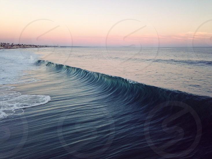 sea waves splashing to sea shore photo