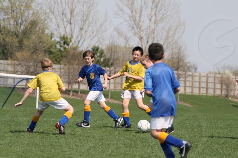 boy's soccer game yellow versus blue photo