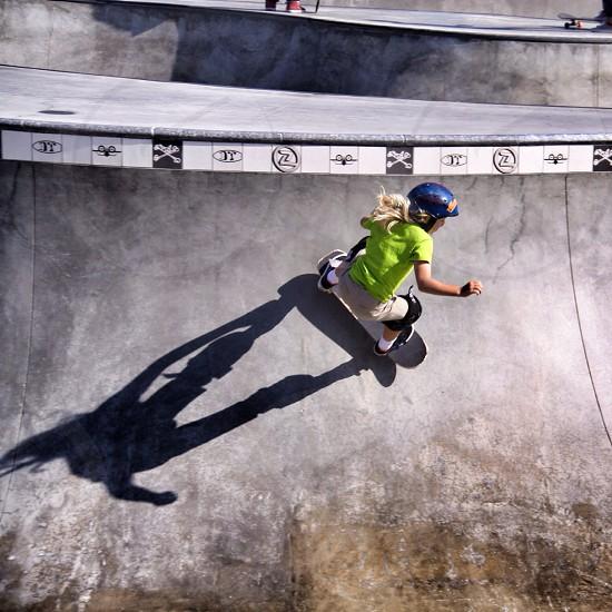girl in lime t shirt on skateboard ramp photo