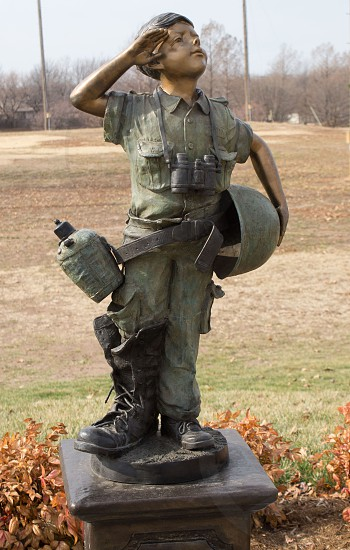 boy in army suit statue photo