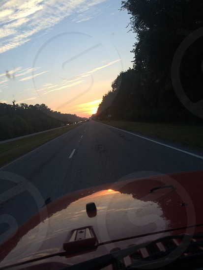 Road trip at sunset in the jeep photo