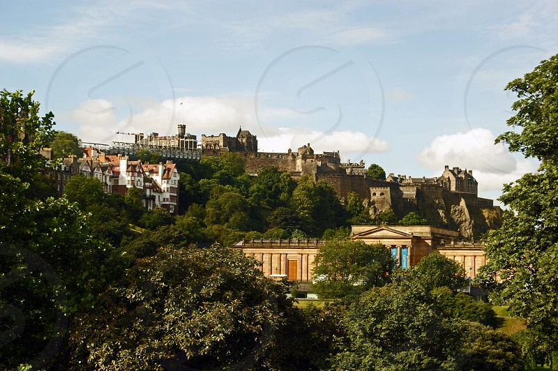 SCOTLAND. Edinburgh.  The view across to the castle from Princes Street. the garnstands are in place on the castle esplanade for the Royal Military Tattoo part of the Edinburgh Festival. In the foreground across Princes Street Gardens are the Royal Scottish Academy and the National Gallery of Scotland. photo