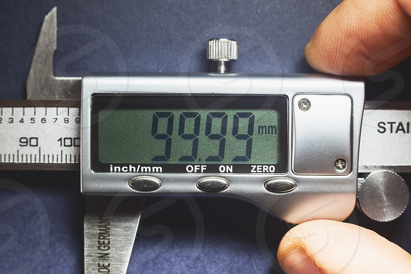 Details of modern measuring tool digital display showing precise dimension in two decimals.  photo