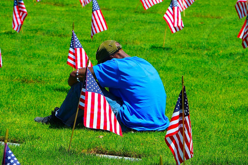 A young man mourns the passing of his brother-in-arms on Memorial Day. photo