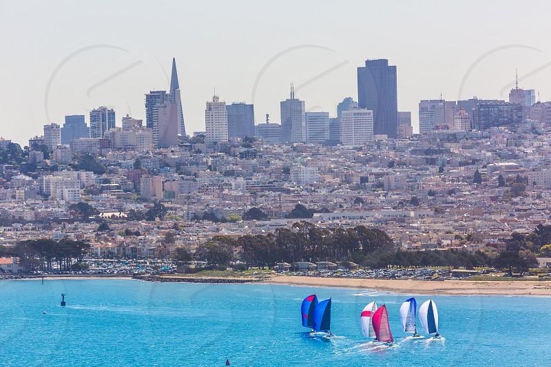 San Francisco view from Golden Gate Bridge sailing regatta in California USA photo