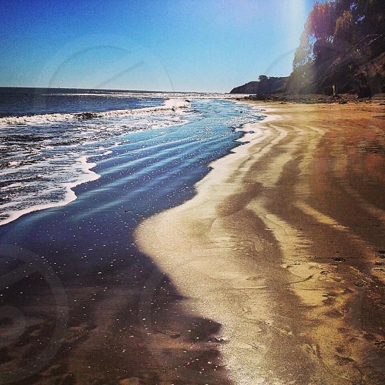 beach line under the sunrays view photo