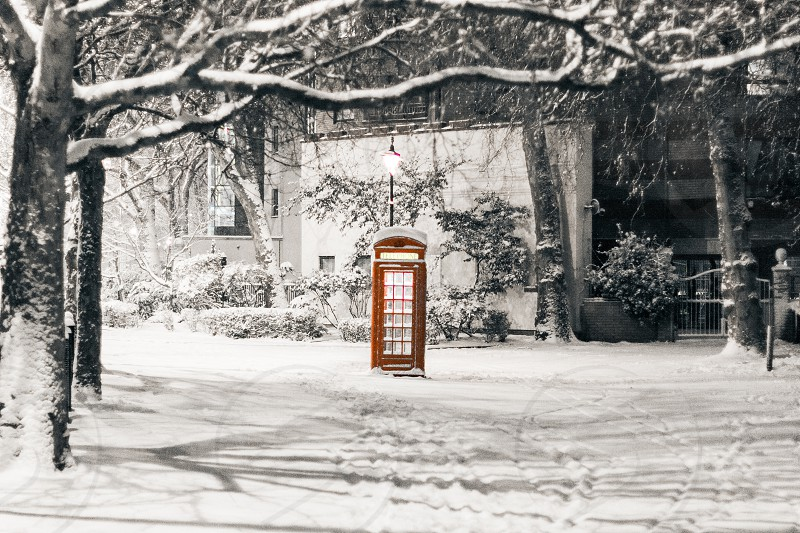 Pretty snow scene of traditional red telephone box The Embankment City of Westminster London UK photo