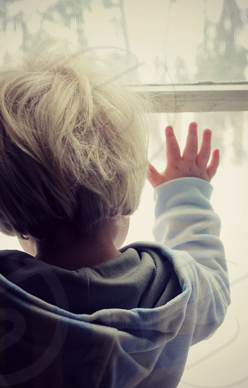 Child toddler winter window alone cold weather hand photo