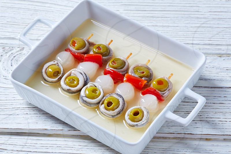 Olives anchovies and pickled onion red pepper pinchos tapas from Spain photo