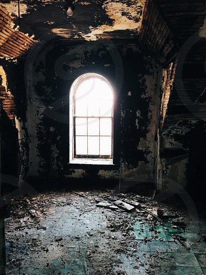 arched window in abandoned building room photo
