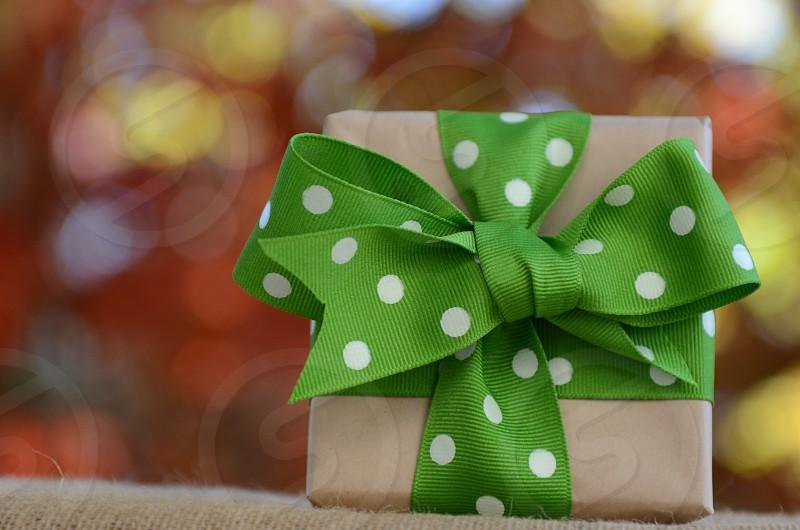 Holidays Christmas present gift wrapping paper box craft paper ribbon green and white polka dot ribbon bow photo