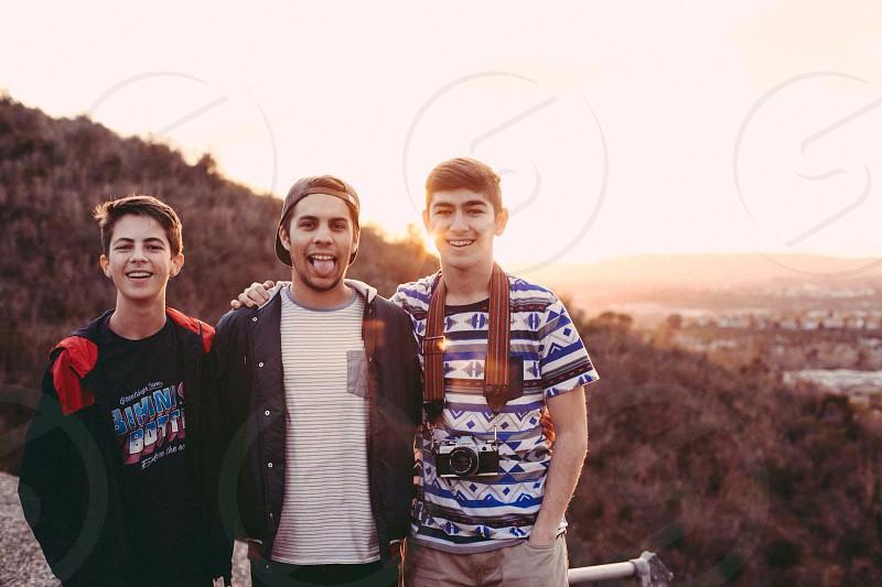 3 men standing smiling photo