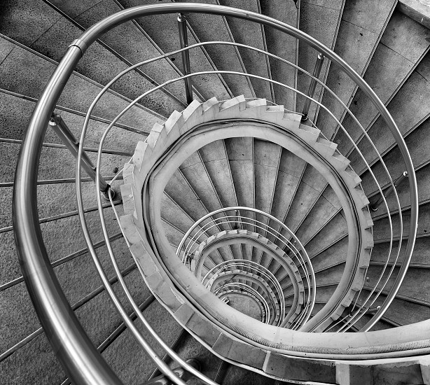 grayscale high angle photo of winding staircase photo