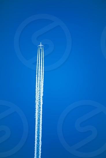 Plane trail blue sky smoke photo