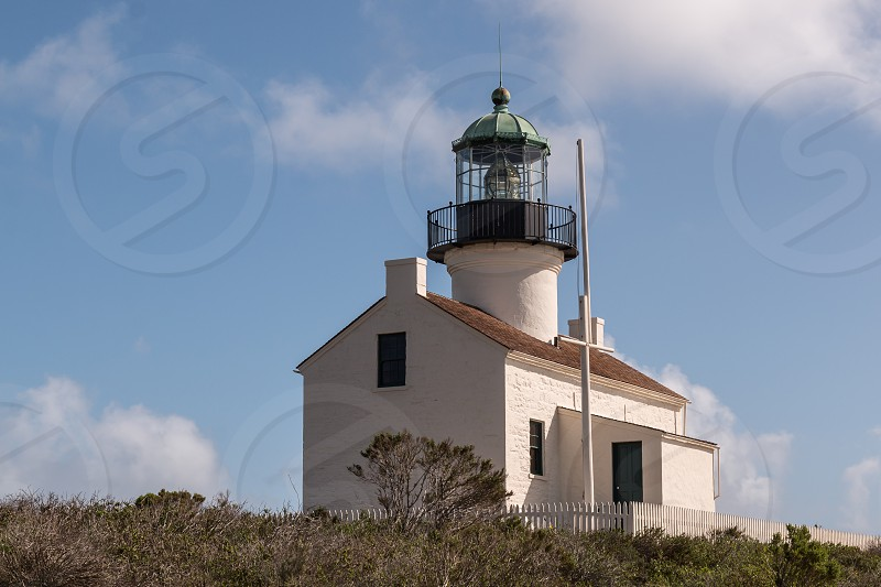 Old Point Loma lighthouse at Cabrillo National Monument in San Diego California.  photo