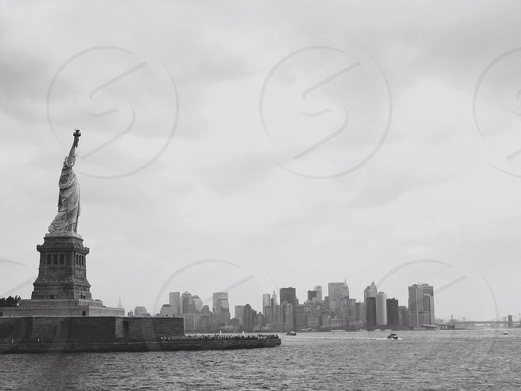 grayscale liberty statue photography photo