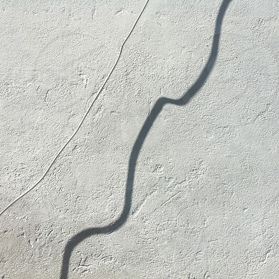 white coated electronic cord with shadow photo