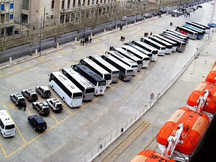 busses parked on street photo