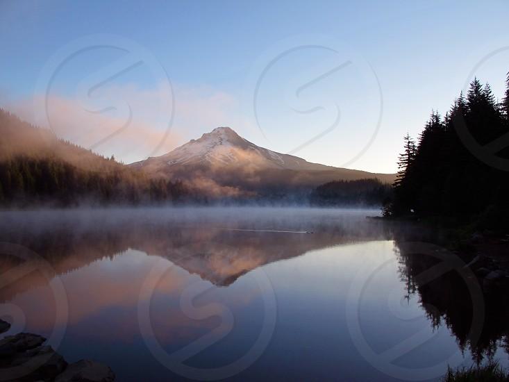 """Duck's Wake Trillium Lake"" Trillium Lake Oregon with Mt. Hood Reflected in the water. Keywords: Mist Fog Sunrise Mountain photo"