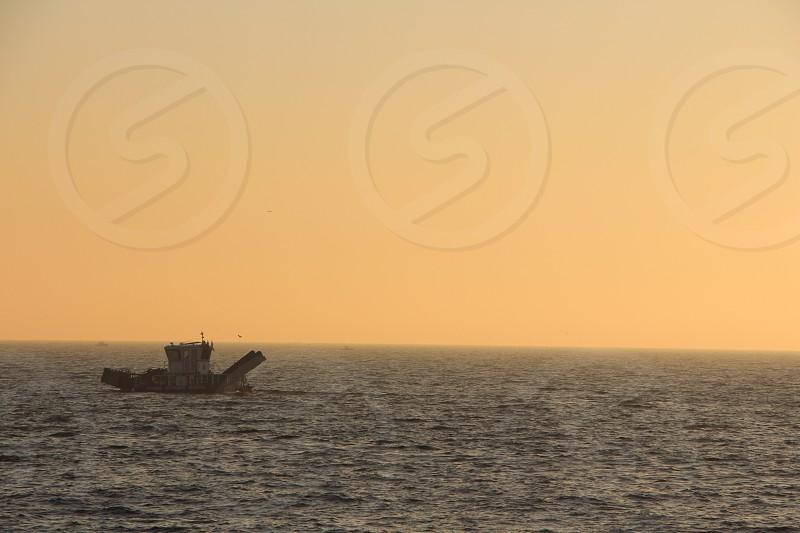 sea evening sunset boat fishing horizon world view beauty skyline photo