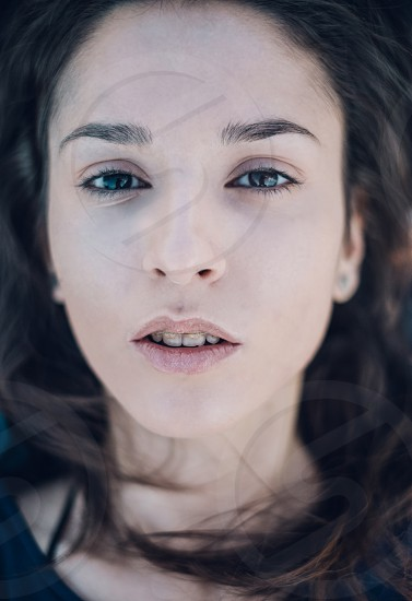 brunette brown eyed woman face close up photo