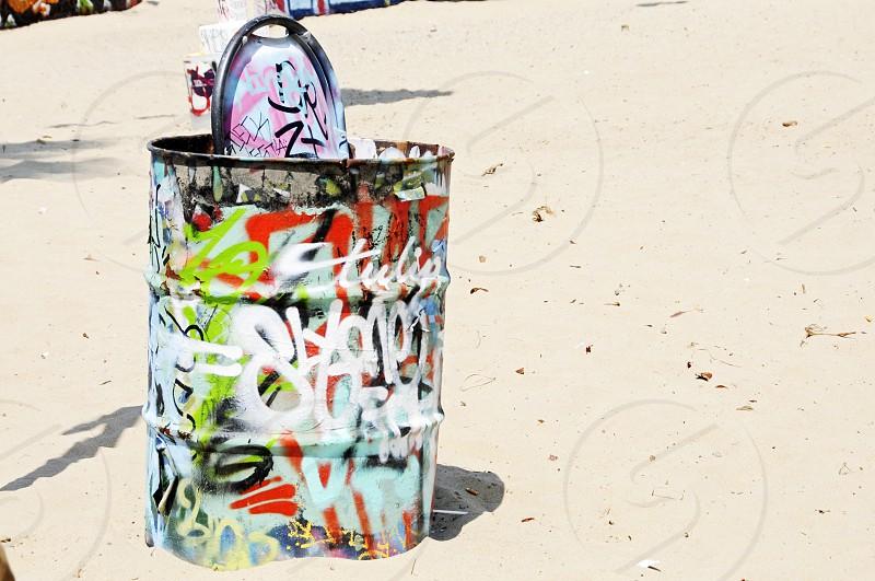 garbage can graffiti beach photo