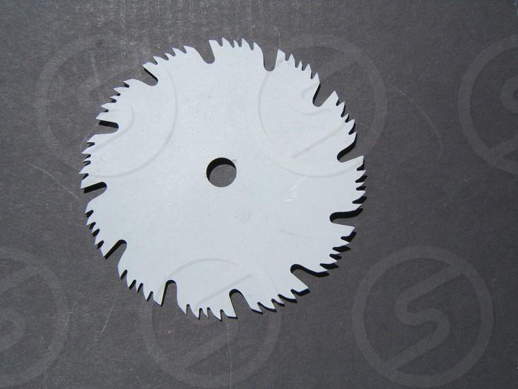 Silver grey circular saw blade. Tool photo